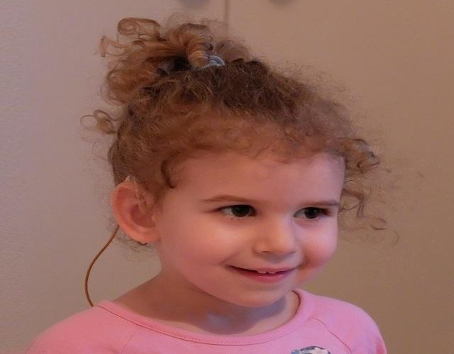 Little girl with hearing aids