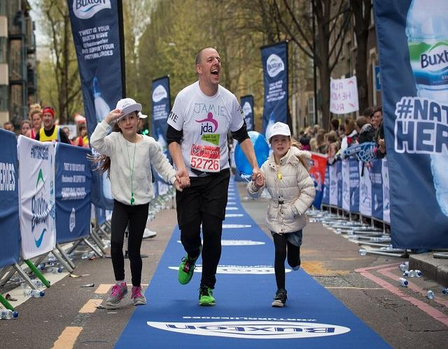 Jamie Cotsen at the marathon finish line with his two children