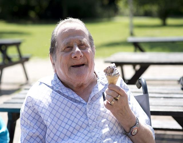 Man in wheelchair holding an ice cream